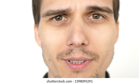 Face of young attractive talkative man on a white background