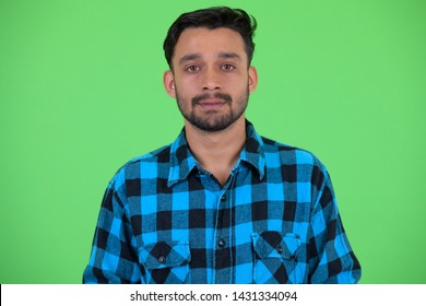 Face of young bearded Persian hipster man