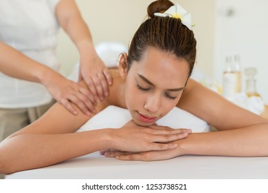 The face Young beautiful Asian woman sleep relaxing in the Oil spa massage in salon.