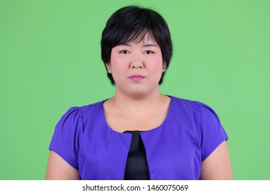 Face of young beautiful overweight Asian woman