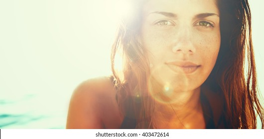 Face of young beautiful woman in summer sun