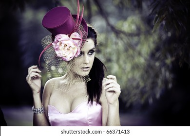 Face of young beautiful woman in a vintage hat outdoors