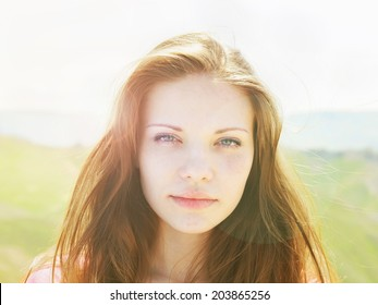 Face of young caucasian beautiful  women in summer nature