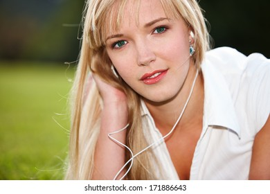 Face of young female listening to music