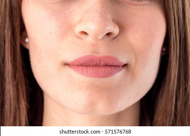 the face of a young girl where are visible the nose and lips