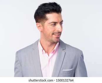 Face of young handsome businessman in gray suit