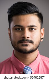 Face of young handsome Indian man