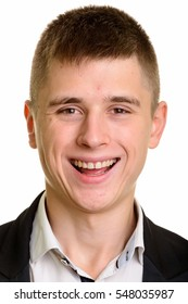 Face of young happy businessman smiling isolated against white background