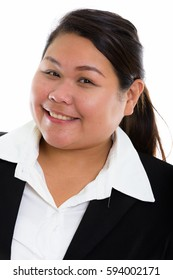 Face of young happy fat Asian businesswoman smiling