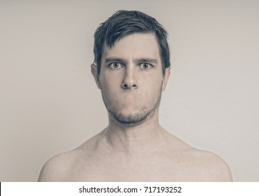 Face of young man without mouth. Censorship concept.