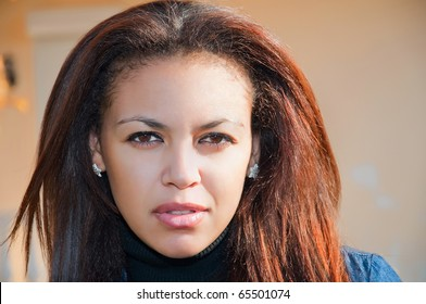 face of a young mulatto woman close-up, beautiful almond eyes