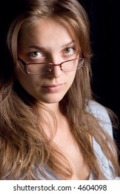 Face of young woman with glasses close up
