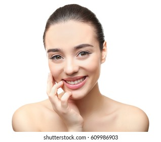 Face of young woman on white background