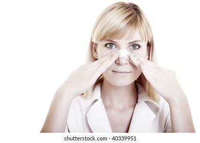 Face of young woman with sticking plaster on nose on the white background