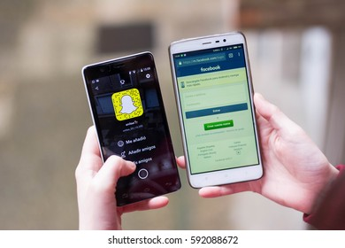 Facebook against snapchat, snapchat in the stock market. Two phones and a young girl with both apps.