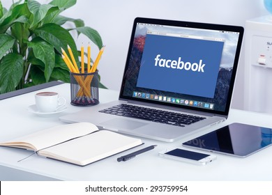 Facebook new logo on the Apple MacBook Pro Retina with an open tab in Safari browser that is on office desk. Facebook is the most popular social network in the world. Varna, Bulgaria - May 29, 2015.
