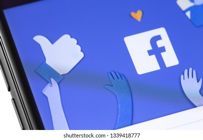 Facebook start page on the screen smartphone. Facebook is largest and most popular social networking site in the world. Moscow, Russia - March 15, 2019
