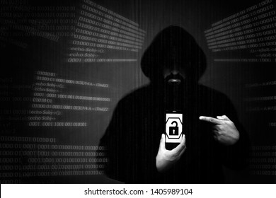 A faceless anonymous hacker uses a smartphone to hack a smartphone. Concept of cyber crime. Personal data theft by mobile phone, theft of account passwords and bank account money.