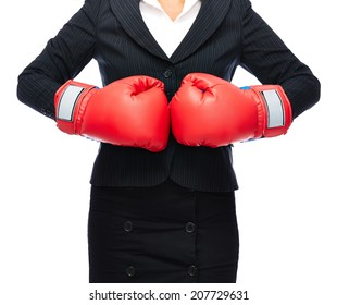 Faceless business woman punching gloves together.   Isolated on a white background.