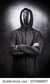 Faceless character with the mirror mask on grey background.