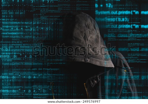 Faceless Hooded Anonymous Computer Hacker Programming Stock Photo