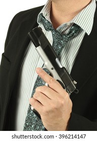 Faceless man in a suit holding a gun