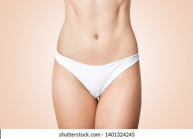 b17b6e138cc Faceless photo of woman in panties showing her perfect flat belly