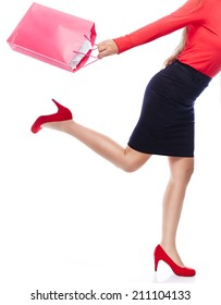 Faceless woman with shopping Bag running