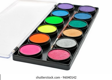 facepaint palette and brush over white background