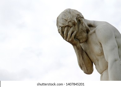 Facepalm - ashamed, sad, depressed. Statue with head in hand