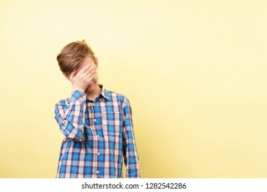 facepalm, desperate frustrated boy covering his face with hand feeling ashamed embarrassed over empty space, advertisement or product placement, banner or poster template, emotion facial expression
