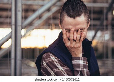 facepalm. desperate frustrated man covering his face. hopeless situation and regret or hangover. portrait of a young guy. emotion facial expression and feelings concept.