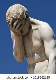 Facepalm statue with head in hands in Paris
