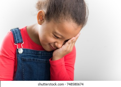 Facepalm. Studio portrait of disappointed african girl holding hand on his head.