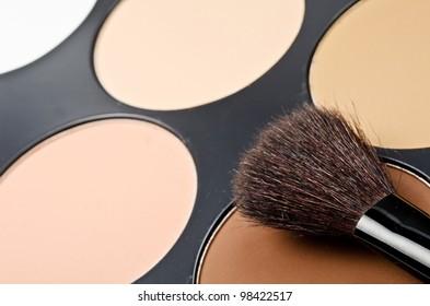 Face-powder box and black single brush