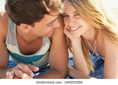 Faces of beautiful young couple relaxing on beach summer holiday, smiling looking with heads together, sunny vacation tourists outdoors. Travel holiday coastal leisure recreation, relaxing lifestyle.