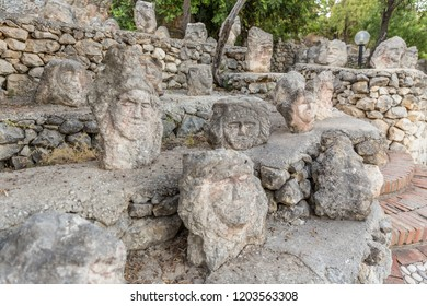 Faces engraved on the rock. Enchanted Castle of Sciacca, open-air museum (Agrigento, Sicily)