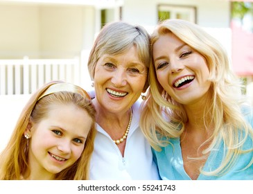 Faces of grandmother with adult daughter and granddaughter in line
