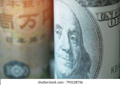 Faces of leader US dollar, Japanese yen, banknotes currencies of countries in the world. Financial and Business concept