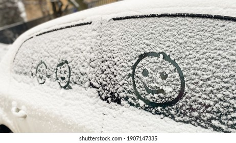 faces painted on car glass