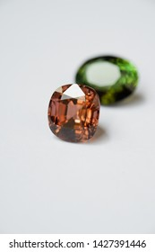 Faceted Cushion-shape Pinkish Brown Tourmaline and Oval-shape Green Tourmaline- selective focus