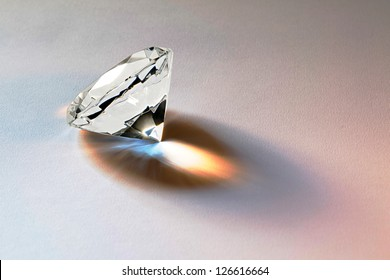 Faceted diamond gemstone with brilliant internal refraction to be mounted in jewelry or bought as a loose stone for investment