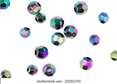 Faceted multi-colored beads isolated against white