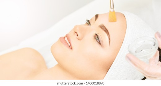 Facial brush peel retinol treatment. Beauty woman peeling procedure. Cosmetology young girl therapy.Hyaluronic acid.