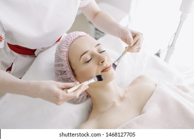 Facial brush peel retinol treatment. Woman peeling procedure. Cosmetology young girl therapy. Hyaluronic acid. Beauty concept