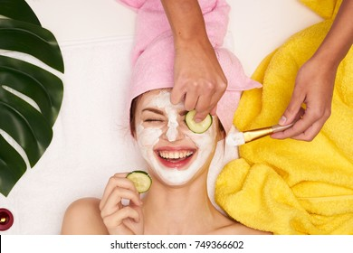 facial cleansing, cosmetology, beauty mask, woman smiling, spa