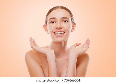 Facial Expressions, Deep Mimic Wrinkles, nasolabial  Folds. Attractive Girl with naked shoulders, looking at camera and Smiling, Lifting Arrows  Lattice