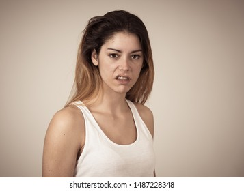 Facial expressions, emotions Anger. Young attractive caucasian woman with angry face. Looking mad and aggressive making furious gestures. Studio portrait in People adolescent mental health concept.