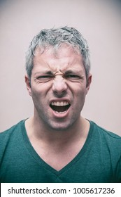Facial expressions - Man manifesting facial expressions typical of anger