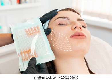Facial lifting thread. Thread facelift with arrows on face for woman's skin, procedure facial contouring using mesothreads. Close up. Concept of plastic surgery.